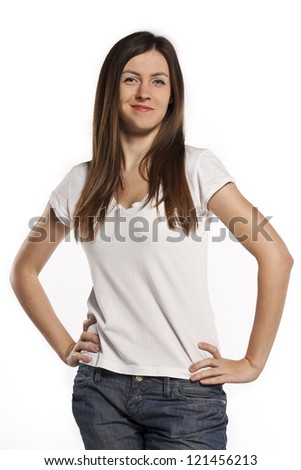 Attractive brunette in the studio in a white T-shirt - stock photo
