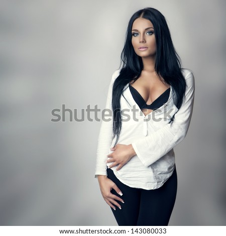 attractive brunette in white shirt and black bra, long hair - stock photo