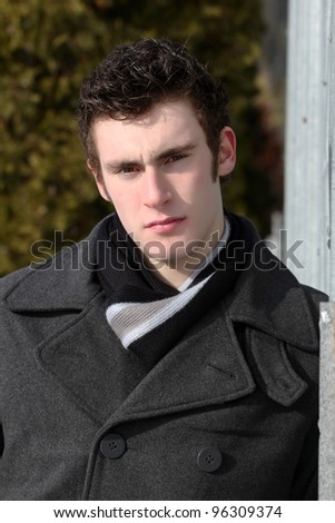 Attractive brunette male outside on a cold winters day - stock photo