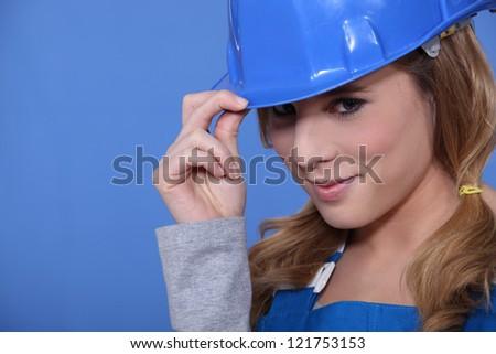 Attractive brunette manual worker - stock photo