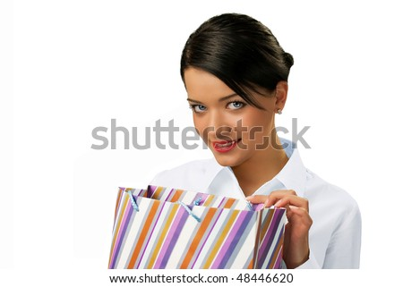 Attractive brunette peeping into paper bag isolated (glamour people isolated on white background series) - stock photo