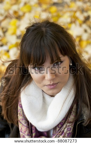 Attractive brunette portrait outdoors - stock photo