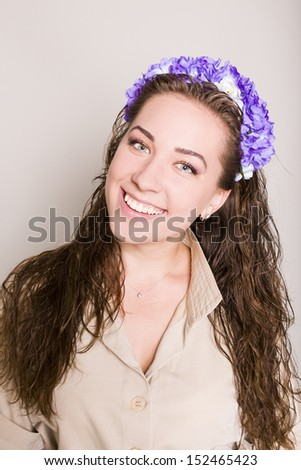 attractive brunette with a hairdress. studio - stock photo