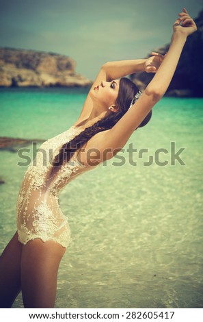 attractive brunette woman on the beach - stock photo