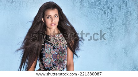 Attractive brunette woman with long healthy hair. Studio shot. - stock photo