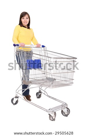 attractive brunette woman with shopping cart. over white background - stock photo
