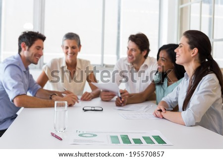 Attractive business people working hard and discussing at a business meeting - stock photo