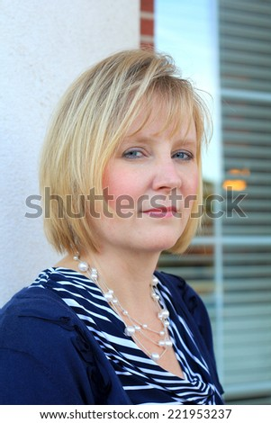 Attractive Business Professional Blonde Business Woman Serious  - stock photo