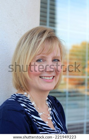 Attractive Business Professional Business Woman Happy and Smiling Mature Adult Mom Baby Boomer  - stock photo