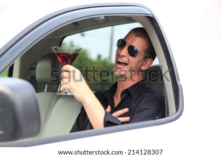Attractive Business Professional Drinking and Driving Laughing and Happy Foolish and Dangerous Holding Alcohol - stock photo