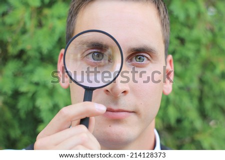 Attractive Business Professional Holding Magnifying Glass Detective Searching - stock photo