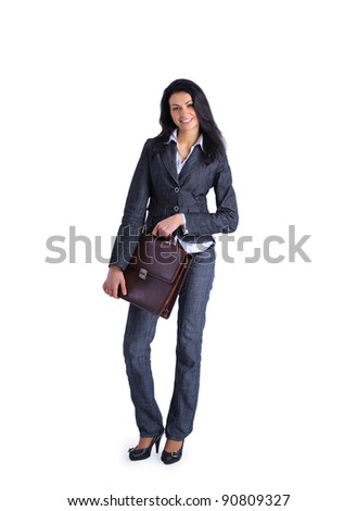 Attractive Business woman holding a briefcase standing on white background - stock photo