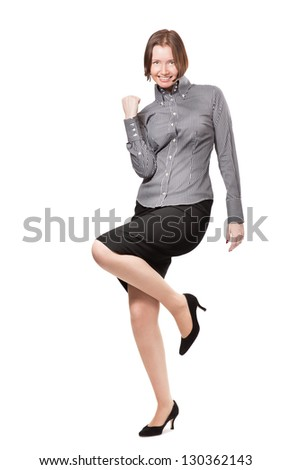 Attractive business woman in formal suit  shows victory emotion - stock photo
