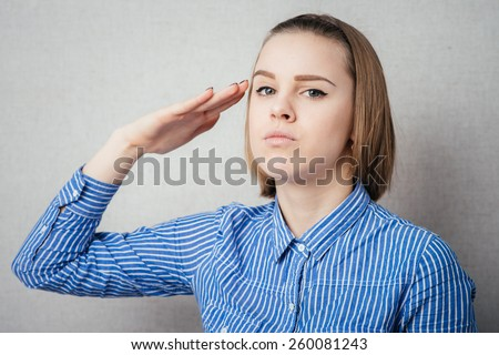 Attractive business woman saluting. - stock photo