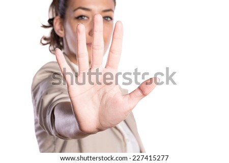 Attractive business woman showing palm of the hand - stock photo