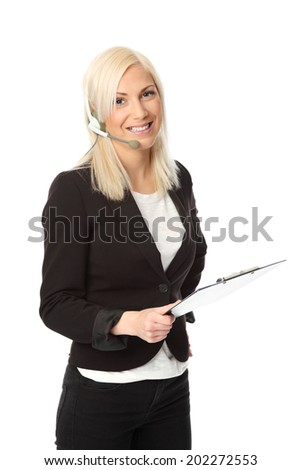 Attractive business woman wearing a black jacket with a white shirt. Wearing a headset and holding a clipboard. White background. - stock photo
