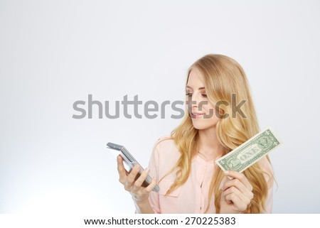 Attractive business woman, wearing a suit and shirt. Holding a dollar and calculator - stock photo