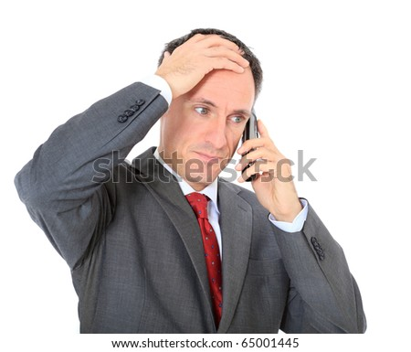 Attractive businessman getting bad news. All on white background. - stock photo
