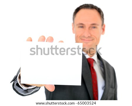 Attractive businessman holding blank white card. Focus on card in foreground. All on white background. - stock photo