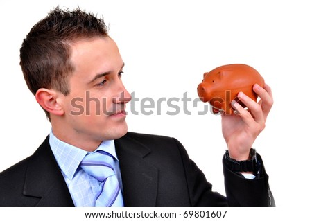 Attractive businessman holding piggy bank. All on white background - stock photo