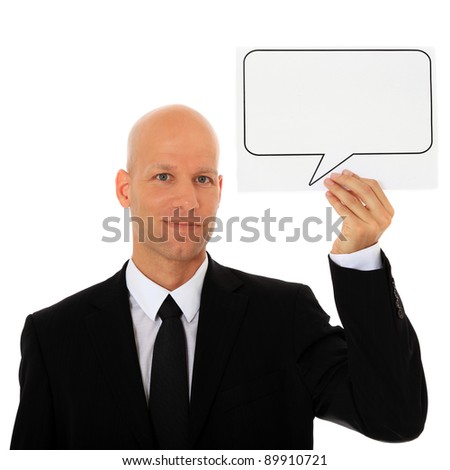 Attractive businessman holding speech bubble next to his head. All on white background. - stock photo