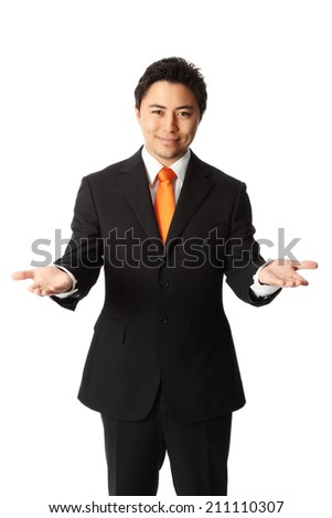 Attractive businessman in a suit and tie, showing. White background. - stock photo