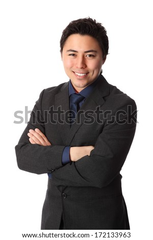 Attractive businessman in a suit with a blue tie and shirt. White background. - stock photo