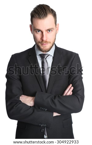 Attractive businessman in his 20s wearing a black suit with an black tie. White background. - stock photo
