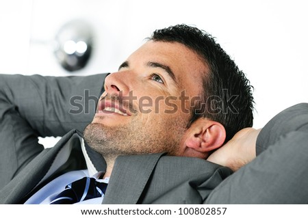 Attractive businessman is taking break from business - stock photo