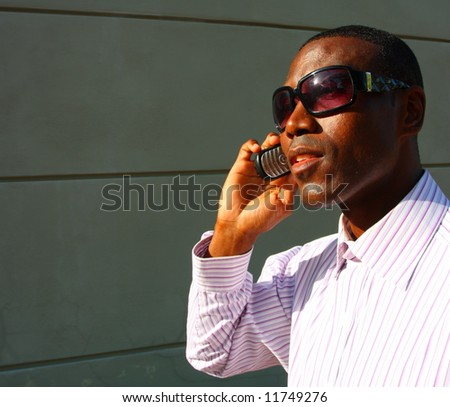 Attractive businessman on the phone - stock photo
