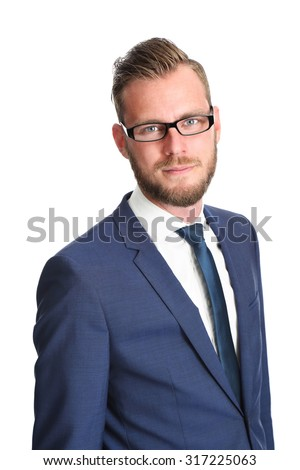 Attractive businessman standing in a blue suit and tie, wearing glasses. White background. - stock photo