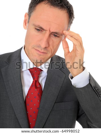 Attractive businessman suffering from headache. All on white background. - stock photo