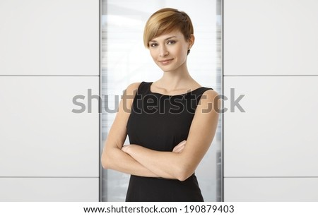 Attractive businesswoman at office. Copyspace on both sides. - stock photo