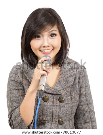 Attractive businesswoman conference speaker during presentation - stock photo