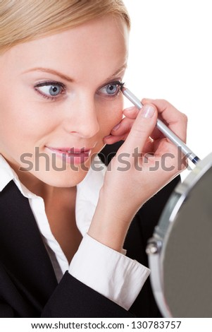Attractive businesswoman drawing with eyeliner. Isolated on white - stock photo