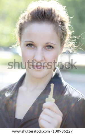 Attractive Businesswoman Holding a Key - stock photo