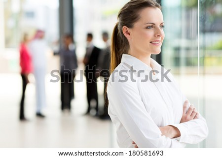attractive businesswoman looking outside window - stock photo