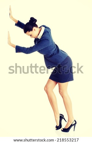 Attractive businesswoman pushing something, isolated on white - stock photo