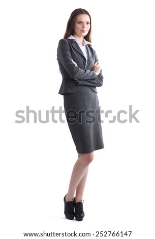 Attractive businesswoman standing in office  with crossed arms. - stock photo