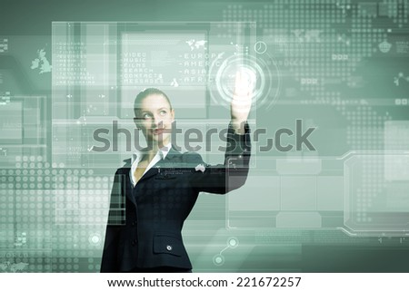 Attractive businesswoman touching icon of media screen - stock photo