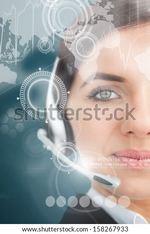 Attractive businesswoman using futuristic interface hologram looking at camera - stock photo