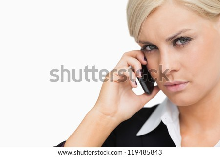 Attractive businesswoman using her mobile against white background - stock photo