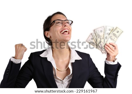 Attractive businesswoman with glasses holding cash earnings - stock photo