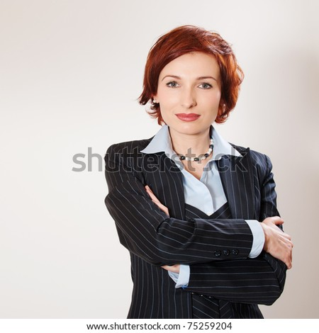 Attractive businesswoman with her arms crossed on white background - stock photo