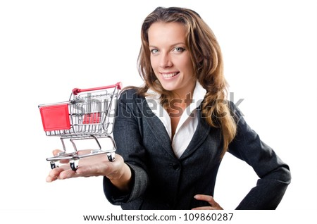 Attractive businesswoman with shopping cart - stock photo