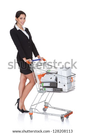 Attractive Businesswoman With Shopping Cart. Isolated On White - stock photo