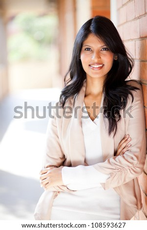 attractive casual female university student portrait on campus - stock photo