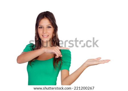 Attractive casual girl in green with the hand extended isolated on white - stock photo