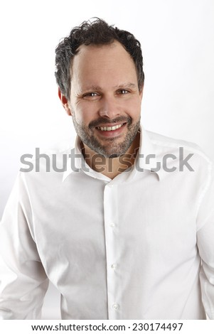 Attractive caucasian man with white shirt looks into the camera - stock photo