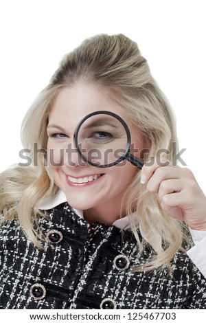 Attractive caucasian woman holding a magnifying glass - stock photo